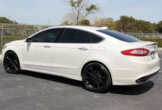 2013 Ford Fusion w/ black rims