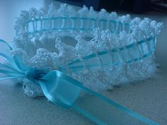 """From the website: A nice simple garter in crochet with picot edging. Slip in a blue ribbon and wear as your """"Something Blue""""!"""
