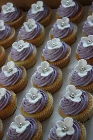 #cupcakes lavender frosting, simple hydrangea flowers and a little silver dot