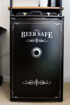 How to paint a mini fridge so that it's an uber masculine addition to an office or man cave. This mini fridge is painted to look like a beer safe! Man Cave Basement, Man Cave Garage, Garage Bar, Man Cave Room, Man Cave Diy, Basement Bathroom, Garage Game Rooms, Stairs Kitchen, Rustic Man Cave