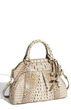BrahminBrahmin-- I'm OBSESSED with their bags..I own several. Gol I love the British!