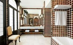 Metallic tiles in a Moorish-inspired pattern enliven a bath at the reimagined Hotel Alfonso XIII in Seville, Spain.