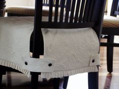 Slipcover for dining room chair using matlasse bed cover. Love this.