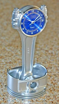 Piston and connecting rod desk clock.This desk clock is handcrafted from a recycled Dodge Viper piston  and connecting rod painted in metallic silver.