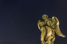 """Orion and the Angel - Angel with the Crown of Thorns, """"In aerumna mea dum configitur spina"""". In the background the constellation of Orion."""