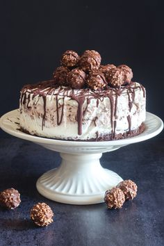 This Easy Ice Cream Cake is made with a chocolate wafer base, two types of no churn ice cream, Ferrero Roche Chocolates and a drizzle of melted chocolate to bring it all together. Waffle Ice Cream, Ice Cream Cookie Sandwich, Sandwich Cake, Ice Cream Cookies, Melted Ice Cream Cake Recipe, Lemon Cookies, Cake Cookies, Delicious Chocolate, Homemade Chocolate