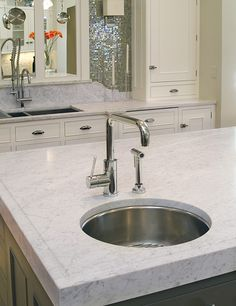 Alternative to marble - super white granite. I need to remember this when the time comes to redo our kitchen.