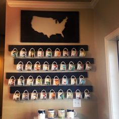 Coffee Mug Display  1x4's black paint C shaped screw hooks  I had Lowe's cut the wood the size I desired.  Then I painted each board black.  Waited it to dry and screwed in the hooks.  I then screwed the boards directly in the wall to make sure they were stable.  I ordered the map from https://www.etsy.com/shop/wrightawaydesigns.    Perfect for a Coffee Bar or to show off your collection.