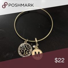Handmade tree of life and M bracelet Gold bangle bracelet with a gold tree of life charm and a gold and charm. 7.5 inches and unhooks to go over hand Jewelry Bracelets