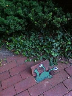 Chalk Art by David Zinn, Michigan. His character Sluggo can be seen in different, humorous poses around the city!