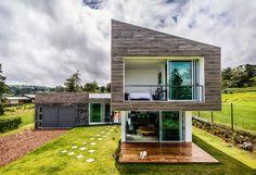 Galeria de Casa Vistas ao Vulcão / ARQ. Arte y Diseño Digital - 1