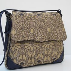 *Flapover with magnetic snap covers the front pocket and main compartment  *Full width zippered pocket on the backside  *Fully lined interior has a