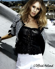 Dylan Penn finds her mysterious side in the Fay lace corset. As seen in L'Officiel Nederland.