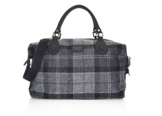 The Shadow Tartan Explorer by Barbour is a carryall day bag made from British wool tartan for overnights or to carry the needs for the day. Trimmed in wax cotton with a removable and adjustable webbing and leather shoulder strap. Inner zip security pocket. External woven Abraham Moons label.
