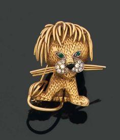 VAN CLEEF & ARPELS. Années 1960. CLIP en forme de lion en fils d'or jaune. Vintage gold brooch clip pin lion. x