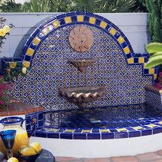 Three-Tier Outdoor Fountain To make your fountain the focal point of the patio, a tiered model is ideal. Here, the Spanish-style patio is focused on the white marble fountain. Outdoor Wall Fountains, Outdoor Tiles, Garden Fountains, Patio Fountain, Water Fountains, Diy Jardim, Mexican Patio, Mexican Tiles, Fire Pit Backyard