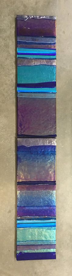 Mosaic Marina Blue Diptych by Alicia Kelemen. Two fused glass and antique color mirror mosaics. Cobalt blue and turquoise, and a tint of lavender-raspberry fused glass panels incorporating glass on the edge are laminated to a MDF base with walnut edge and key holes. This composition can be hung horizontal or vertical, or one next to the other. Each panel is 6