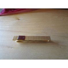 "New Listing Started vintage goldtone tie clip 1.75""long as new stamped emblem then Almeria? £1.55"