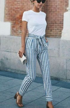 Striped high-waisted tie pants are great paired with a white tee and heels for a spring evening out. Let Daily Dress Me help you find the perfect outfit for whatever the weather! dailydressme.com/