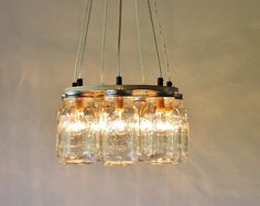 Ring Mason Jar Chandelier Lighting Fixture, 7 Clear Quart Jars, Bulbs Includednull via null . Redecorate your space with style and simplicity! Our Mason jar chandelier Pendant Light Fixtures, Chandelier Lighting Fixtures, Hanging Light Fixtures, Mason Jar Pendants, Mason Jar Chandelier, Light Fixtures, Jar Chandelier, Mason Jar Light Fixture, Mason Jars