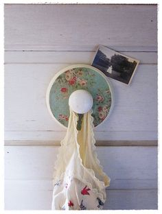 big and pretty hook, with porcelain doorknob. by bee vintage redux. (www.beevintageredux.etsy.com)
