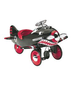 Look! In the driveway! It's a trike, it's a plane, no, it's a pedal plane! This super shark is miles above a normal trike, perfect for petite pilots or any little one who wants to earn their wings. Its charming, retro feel is stocked with modern features like high-traction rubber wheels and non-slip pedals for extra control. Best of all, the propeller spins with every push of the pedals.
