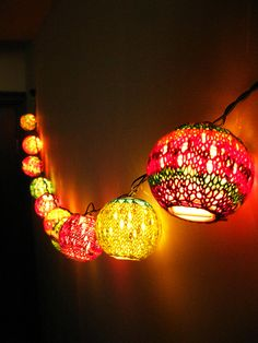 Illuminate Your Sock Yarn Lanterns by Abi Grasso. Store bought party lights covered in remnants of sock yarn. too cool! Pattern is free,