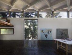 dellekamp arquitectos' waffle ceiling bounces light around this artist's studio in mexico