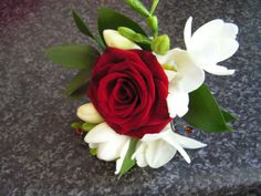 Red roses and freesias but change out red for blush for grandmothers White Rose Bouquet, Rose Wedding Bouquet, White Wedding Flowers, White Roses, Corsage And Boutonniere, Boutonnieres, Sunflower Bouquets, Floral Bouquets, Red Roses And Sunflowers
