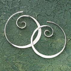 """Koru Spiral Earrings  Named by the Maori for the spiral-shaped fern of New Zealand, the koru reaches toward the light—strives for perfection—represents new beginnings. These koru earrings are hammer-textured sterling silver. Handcrafted. 1"""" diam. (approx.).  ****  Koru Spiral Earrings  Item #:P434752  Price:29.95"""