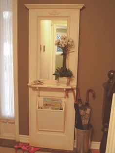 """""""Hall Tree"""" from an old door and trim and a little extra wood."""