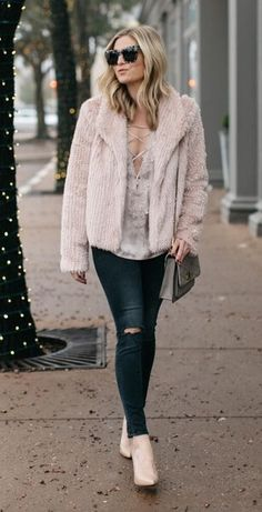 Harsh ripped denim is softened beautifully with pale pink brushed faux fur - the ladylike Instagrammer's top pick.#winteroutfits #winter #outfits
