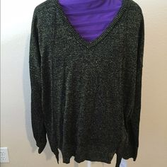 Liz Claiborne Sparkle Sweater This is brand new with the tags still on it.  It is a V-neck, long sleeve, size medium.  It looks like a sweater but is not very heavy.  It is silky and flowing.  It has a sparkle throughout the fabric.  Very glamorous. Liz Claiborne Sweaters V-Necks