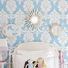 Three white-painted sunbursts in a girl's room. Love especially the one in the center.