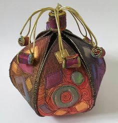 Was now This is a handmade three dimensional textile pod, a textile treasure, the main body of the pod can be opened up but not completely, the coils on the end of the gold cord stop the main coil coming off. Fabric Art, Fabric Crafts, Textile Sculpture, Fabric Bowls, Creative Textiles, Fibre And Fabric, Art Bag, African Fabric, African Textiles