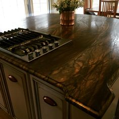Our kitchen is shaping up nicely. Stunning custom island in Sandalus quartzite.