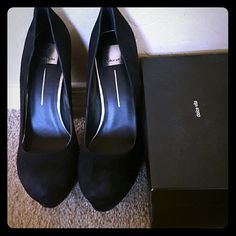 Dolce Vita Bryann Black Suede Pumps Suede upper in a dress pump style with a round toe Leather lining and cushioned footbed 1 1/4 inch platform midsole Smooth leather outsole 4 1/2 heel Dolce Vita Shoes Platforms