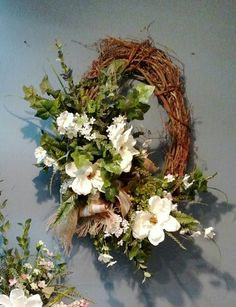 Magnolia & dogwood grapevine wreath with ivy and maidenhair. Burlap and lace ribbon. Designer: H Cooper Summer Door Wreaths, Diy Fall Wreath, Wreath Crafts, Holiday Wreaths, Magnolia Wreath, Wedding Wreaths, Grapevine Wreath, Grape Vines, Flower Arrangements