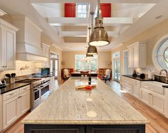 Dan, Here are white cabinets with River White Granite with Killim Beige paint from Sherwin Williams. Not sure about this. I do not like two different kinds of granite and two different cabinet colors in same kitchen.