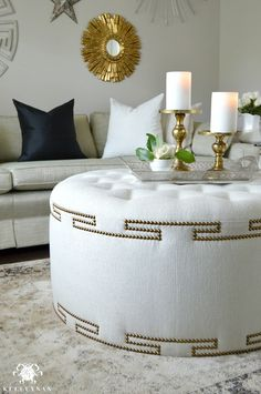 Elegant Uphostered Ottoman with Gold Nailhead Trim