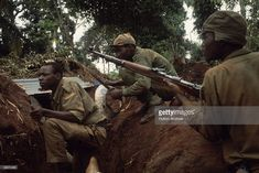 Nigerian men wear camouflage and hold their rifles as they move through the wilderness, during Nigeria's Biafran civil war. Members of the Ibo tribe rebelled in 1967, demanding a separate Republic of Biafra. The war and famine lasted until 1970, when the decimated Biafran Republic surrendered to federal forces.