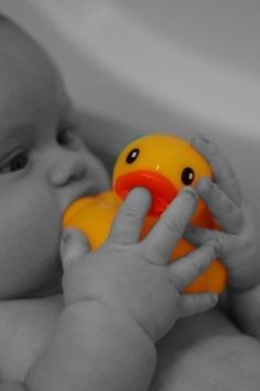 Black & white with a splash of color.  Baby poses photography