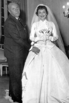 October 21 1955 – On the set of The Ambassador's Daughter with actress Olivia de Havilland, who wore a Dior-designed wedding dress for her part in the film.
