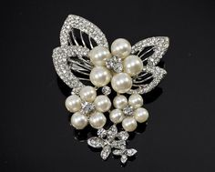 Welcome to The Bright shop! We have a variety of rhinestone brooches and buttons to choose from!    This listing is for: 1 Pc Crystal and pearl