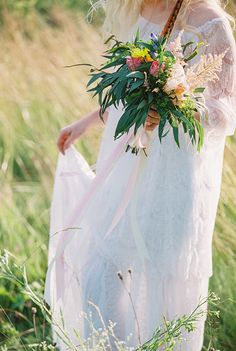 vibrant flowers + feather bouquet for Bohemian wedding inspiration shoot in the countryside with a dose of vibrancy   photo by Igor Kovchegin   http://www.fabmood.com/bohemian-wedding-inspiration-shoot/ Fab Mood - UK wedding blog #bohemian