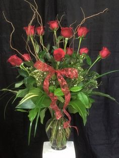 Who doesn't love a dozen red roses? We sure adore them!