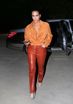 Kim Kardashian-West Steps Into Autumn With a Pumpkin Spice Palette | Vogue Leather Jeans, Leather Jacket, Orange Color Palettes, Latest Outfits, Celebs, Celebrities, Guys And Girls, Girls Night, Kim Kardashian