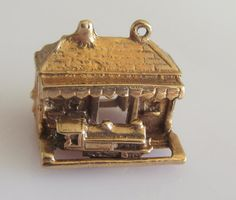 A large vintage 9ct gold moving Steam Train in a Station Charm - G&H London Year 1966.