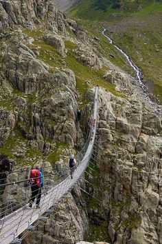 Trift Bridge - Triftbrücke    Trift Bridge is one of the most spectacular pedestrian suspension bridges of the Alps. It is 100 meters high and 170 meters long, and is poised above the region of the Trift Glacier. Even reaching the bridge through the ravine by cable car is an adventure.