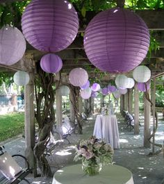 Lunabazaar.com has a huge selection of cheap (starting at $0.80 each) paper lanterns (over 60 colors!), pom poms, and other lanterns and decorative accessories. Battery-powered individual LED lights for paper lanterns are $3.50 each or $2.75 ea for 24+ if we wanted to have any lit. This blog post has some helpful advice on how to plan (number and type needed) and install paper lanterns for an event